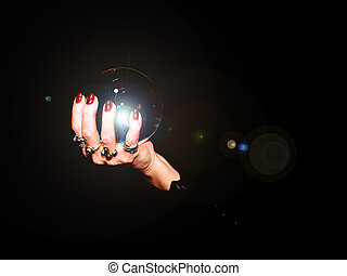 crystal ball - A crystal ball is held in the hands of a ...