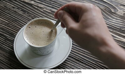 A cup of cappuccino with foam is on the table - A cup of...