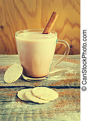 A cup of cocoa with cinnamon, vintage style, image tinted