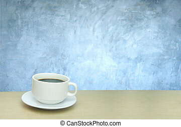 a cup of coffee and background of concrete wall texture