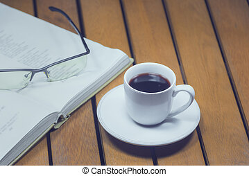 A cup of coffee and book
