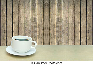 a cup of coffee and old wood wall texture