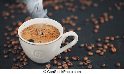 A Cup of Coffee. Falling grains of coffee on the table. Slow motion