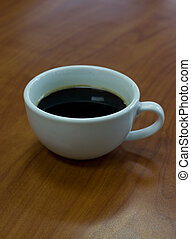 a cup of coffee on table