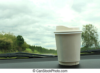A cup of coffee on the console car