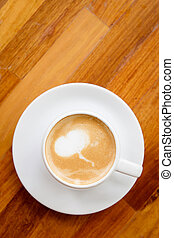 A cup of coffee on wooden background