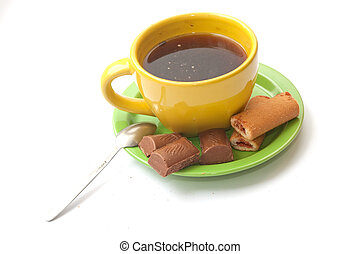 A cup of coffee with biscuits and chocolate