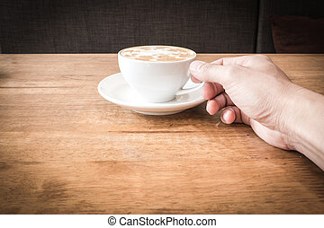 A cup of coffee with man hand