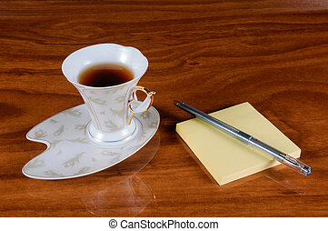 A cup of coffee with notebook