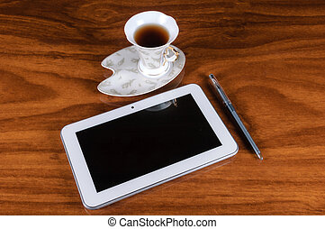 A cup of coffee with your tablet