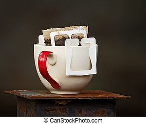 A cup of drip coffee. - Instant freshly brewed cup of coffee...