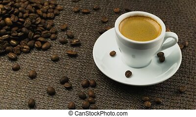 A cup of espresso, a handful of coffee beans