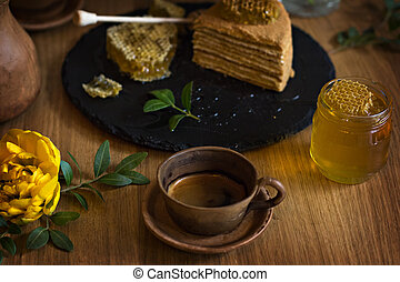 A cup of espresso and a cake