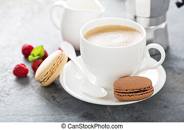 A cup of espresso coffee with macarons