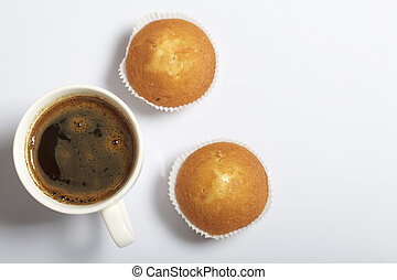 A cup of freshly brewed coffee and muffins. On a white background.