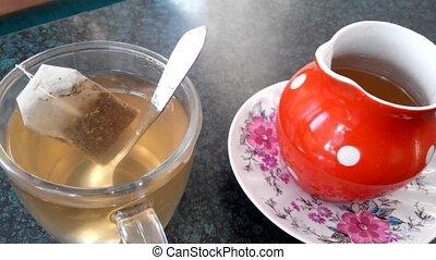 A cup of green tea cools