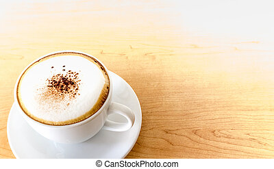 A cup of hot coffee cappuccino on w