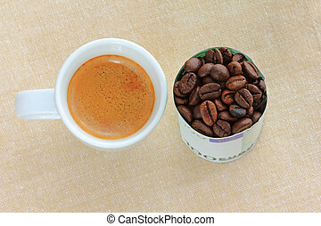 Espresso next to coffee beans