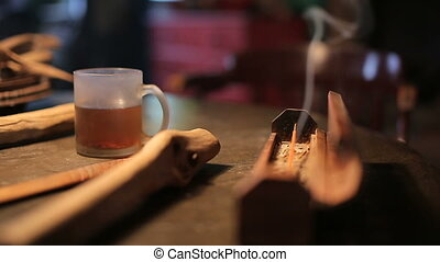 A cup of hot tea on wooden table