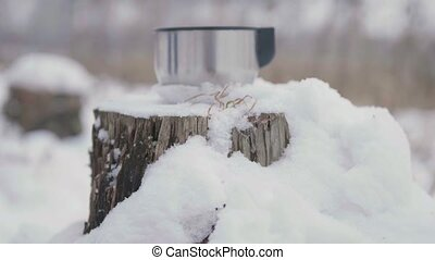 A Cup of hot tea outdoors in winter