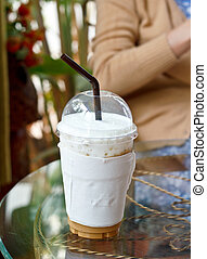 A cup of ice coffee.