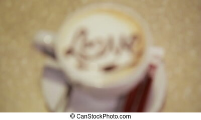 A cup of latte art coffee, love heart symbol