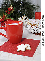 A cup of milk with sugar cookies in the glaze