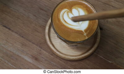 A Cup of Piccolo latte coffee with latte art