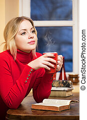 A cup of relaxation. - Gorgeous fashionable young blond ...