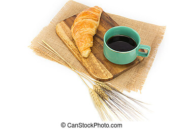 A cup of strong black espresso coffee and fresh croissant isolated on white background, Top view