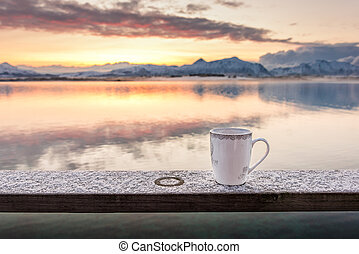 A cup of tea in the morning with a beautiful scenery in the background