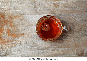 a cup of tea on old wooden table