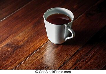 A cup of tea on wooden table