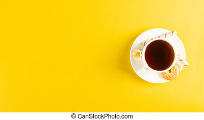 A cup of tea on yellow background