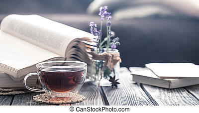 a cup of tea with a book in the interior