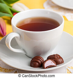 A Cup of Tea with Easter Egg Shaped Chocolate Candies