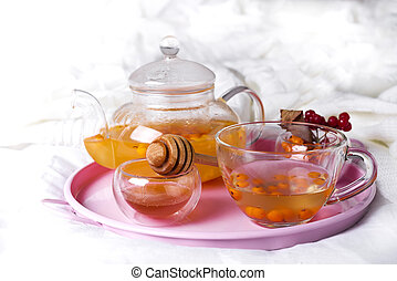 A cup of tea with sea buckthorn and herbs