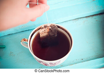 A cup of tea with tea bag