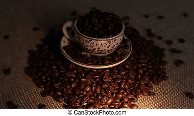 A cup with coffee bean as background