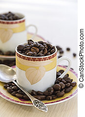 A cup with coffee grains.