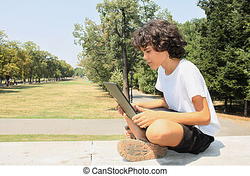 A curly boy with a laptop