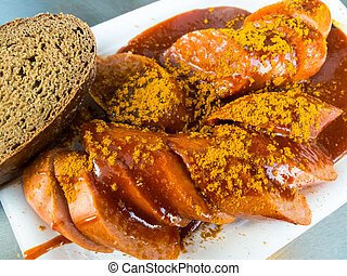 a currywurst at a fast food stand