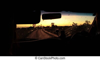 A curvy road shot while inside a car - A medium shot of a...