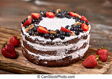 a cut of cake with whipped cream and strawberry fruits on...
