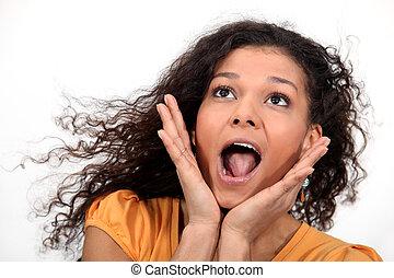 A cute African American woman screaming.