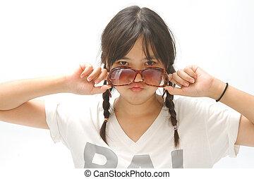 a cute asian  girl wearing sunglasses