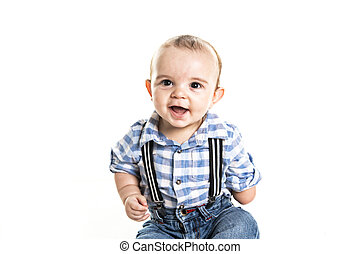 cute baby boy with one hand over white background