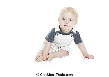 Cute baby with big blue eyes in denim on white background.
