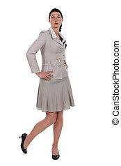 A cute brunette businesswoman posing.