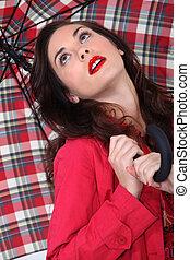 A cute brunette with an umbrella.